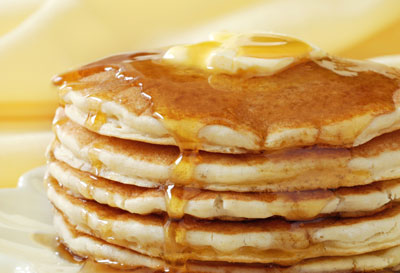 Stack of pancakes with a pat of butter on top